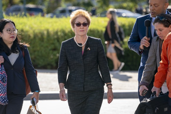 FILE - In this Oct. 11, 2019, file photo, former U.S. ambassador to Ukraine Marie Yovanovitch, center, arrives on Capitol Hill, Friday, Oct. 11, 2019, in Washington, to testify before congressional lawmakers as part of the House impeachment inquiry into President Donald Trump. (AP Photo/J. Scott Applewhite, File) Marie Yovanovitch