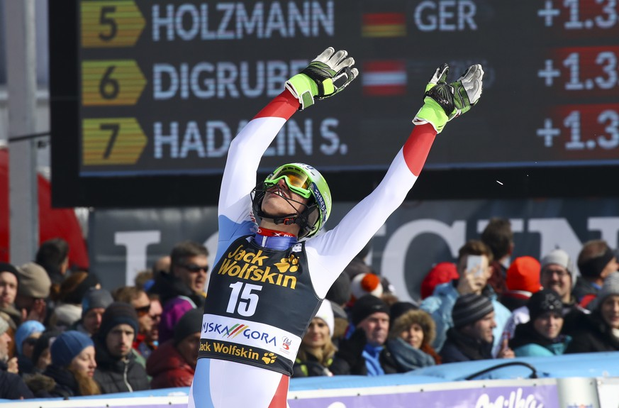 Switzerland's Ramon Zenhaeusern celebrates after completing an alpine ski, men's World Cup slalom in Kranjska Gora, Slovenia, Sunday, March 4, 2018. (AP Photo/Alessandro Trovati)
