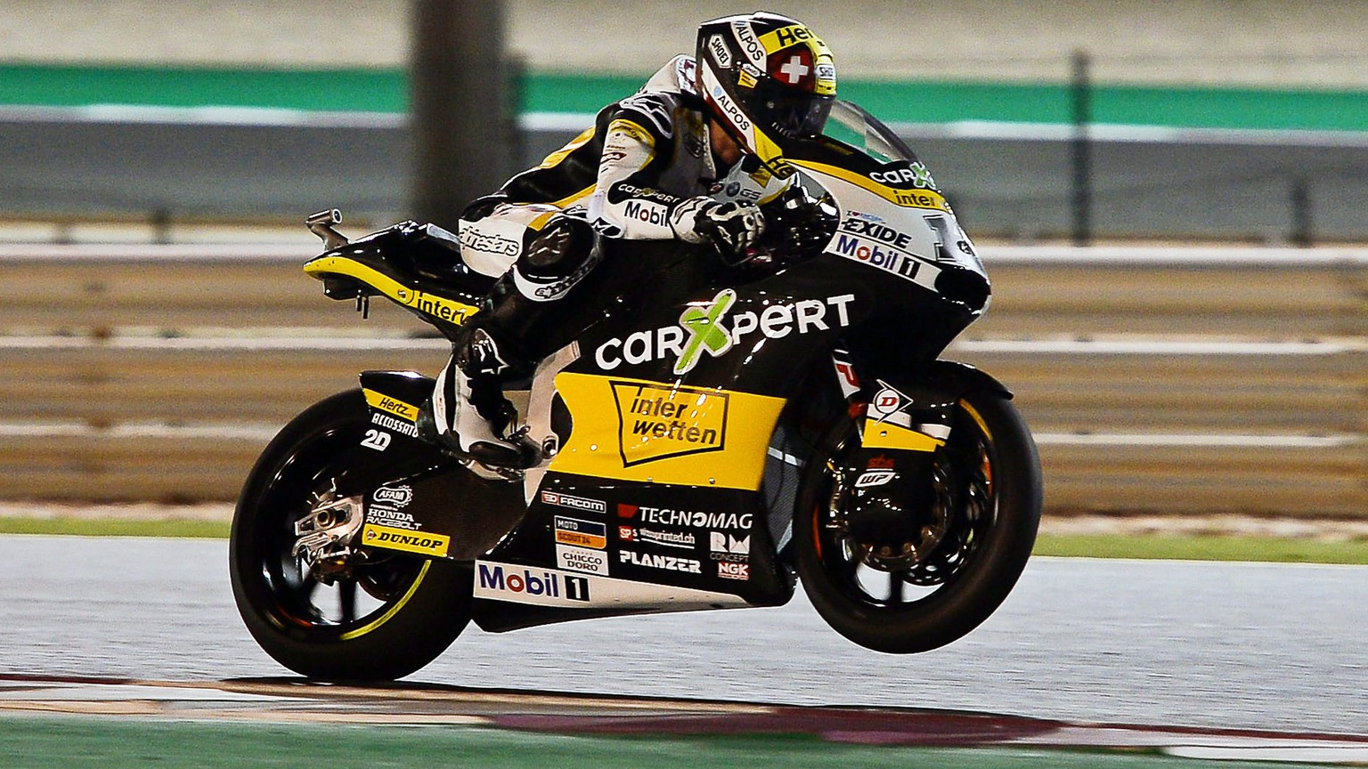 epa05868380 Swiss Moto2 rider Thomas Luthi of the CarXpert Interwetten team in action during a free practice session for the Motorcycling Grand Prix of Qatar at Al Losail International Circuit in Doha, Qatar, 24 March 2017. The 2017 MotoGP World Championship season's first race will be held in Doha on 26 March.  EPA/NOUSHAD THEKKAYIL