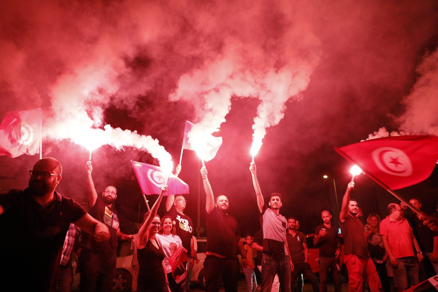 epa07845692 Supporters of Tunisia's jailed presidential candidate Nabil Karoui celebrate in front of his headquarters as results come in, in Tunis, Tunisia on 15 September 2019. The first round of the presidential election in Tunisia was held on 15 September.  EPA/STR