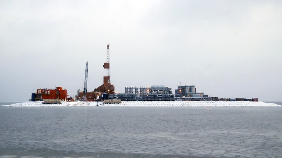 In this October 17, 2017 photo provided by the Bureau of Safety and Environmental Enforcement, oil production equipment appears on Spy Island, an artificial island in state waters of Alaska's Beaufort Sea. The Bureau of Safety and Environmental Enforcement announced Tuesday, Nov. 28, 2017, it has approved an application from Eni U.S. Operating Co. Inc. to drill exploratory wells on federal submerged lands from Spy Island. (Guy Hayes/Bureau of Safety and Environmental Enforcement via AP)