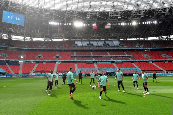epa09271927 Players of Portugal in action during a team training session at the Ferenc Puskas stadium in Budapest, 14 June 2021, one day prior to the Euro 2020 soccer championship group F match Hungary vs. Portugal. EPA/Tibor Illyes HUNGARY OUT