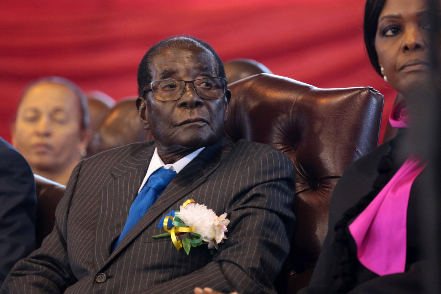 epa06342296 (FILE) - Zimbabwean President Robert Mugabe (C) follows the proceedings of the Day of The African Child at the City Sports Centre in Harare, Zimbabwe, 17 June 2017  (reissued 21 November 2017). Zimbabwe's parliamentary speaker on 21 November said Mugabe has resigned as President.  EPA/AARON UFUMELI *** Local Caption *** 53590607