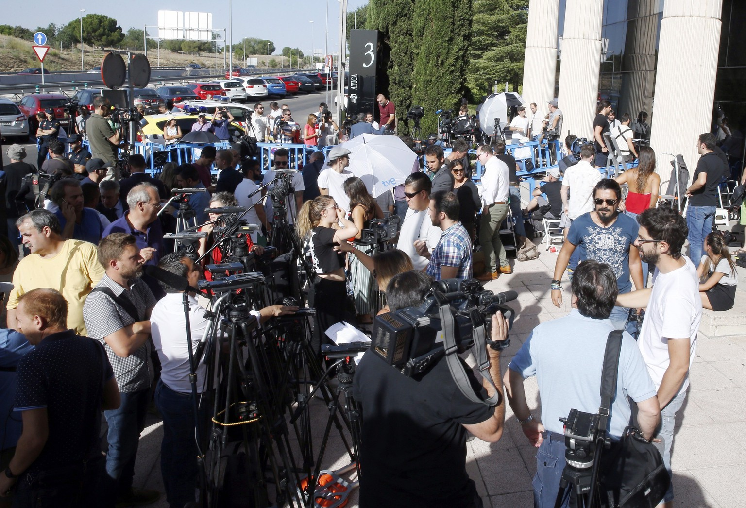 epa06118469 Several journalists wait outside the Examining Magistrate's Court No. 1 for the arrival of Portuguese soccer player Cristiano Ronaldo, in the town of Pozuelo de Alarcon, outside Madrid, Spain, 31 July 2017. Ronaldo is to testify before the judge after he was accused by Spanish Prosecution Office of four offences of tax fraud 14.7 million euro between 2011 and 2014.  EPA/PACO CAMPOS