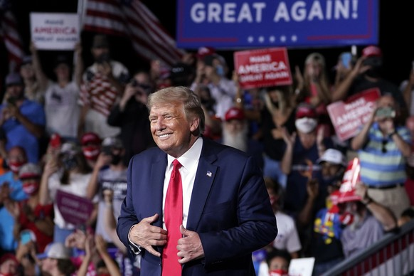 FILE - In this Sept. 8, 2020, file photo President Donald Trump stands on stage after speaking at a campaign rally at Smith Reynolds Airport in Winston-Salem, N.C. Senior aides describe North Carolina as a