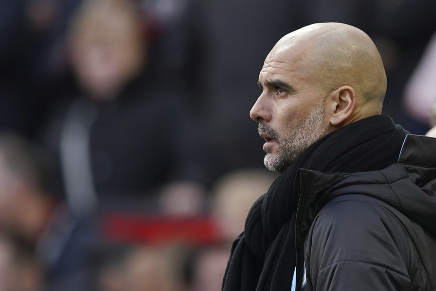 Manchester City's head coach Pep Guardiola watches the English Premier League soccer match between Manchester United and Manchester City at Old Trafford in Manchester, England, Sunday, March 8, 2020. (AP Photo/Dave Thompson) Pep Guardiola