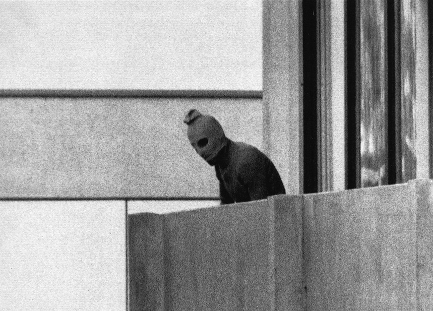 In this Sept. 5, 1972 file photo, a member of the Arab Commando group which seized members of the Israeli Olympic Team at their quarters at the Munich Olympic Village is shown. in's prime minister and top Olympic officials are gathering to mark the 40th anniversary of the deaths of 11 Israeli athletes in a terrorist attack at the 1972 Munich Olympics. (AP Photo/Kurt Strumpf,File)