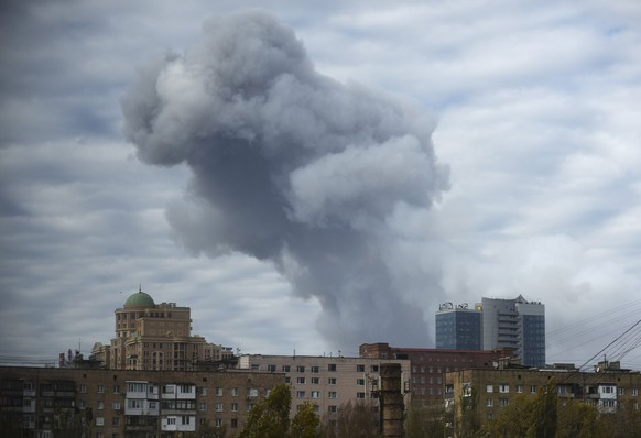 Smoke rises after shelling in the city of Donetsk, eastern Ukraine, Monday, Oct. 20, 2014. A powerful explosion has shaken the largest rebel-controlled city in eastern Ukraine as daily battles continue in the region despite a nominal cease-fire being in place. Shockwaves from the explosion Monday damaged buildings and were felt over a radius of several kilometers. (AP Photo/Evgeniy Maloletka)