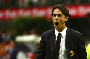 AC Milan's coach Filippo Inzaghi reacts during the Serie A football match AC Milan against Lazio on August 31, 2014, at the San Siro stadium in Milan. AFP PHOTO / OLIVIER MORIN