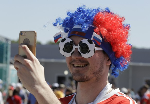 A fan takes a photo prior to the group E match between Costa Rica and Serbia at the 2018 soccer World Cup in the Samara Arena in Samara, Russia, Sunday, June 17, 2018. (AP Photo/Mark Baker)