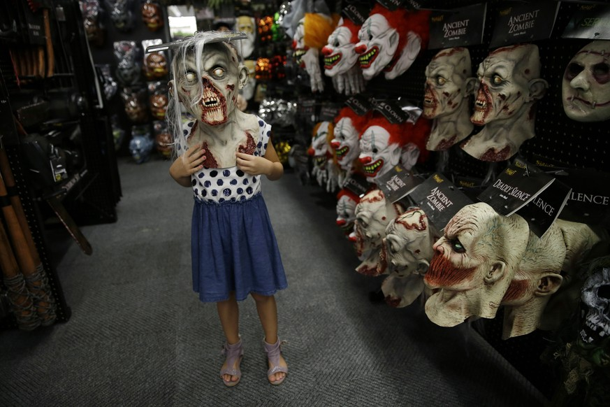 In this Sept. 2, 2015 photo, six-year-old Olivia Vlaicu, of Maywood, N.J., tries on an