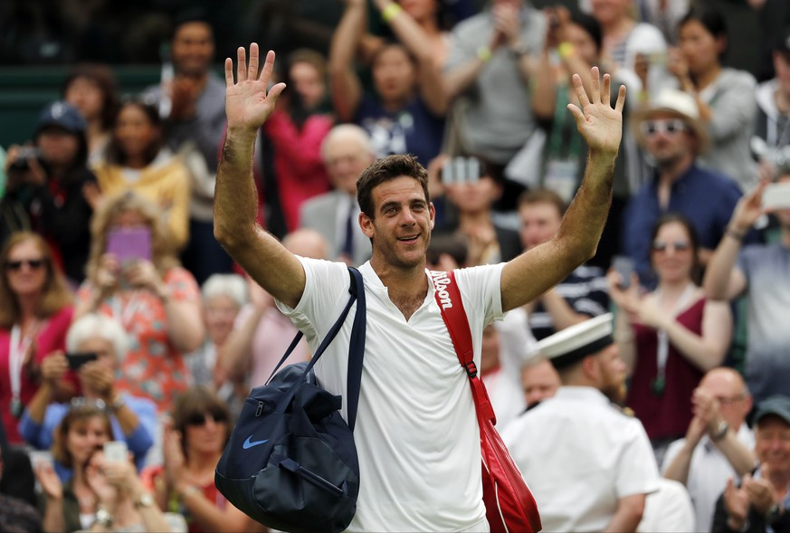 Juan Martin del Potro of Argentina celebrates after beating Stan Wawrinka of Switzerland in their men's singles match on day five of the Wimbledon Tennis Championships in London, Friday, July 1, 2016. (AP Photo/Ben Curtis)
