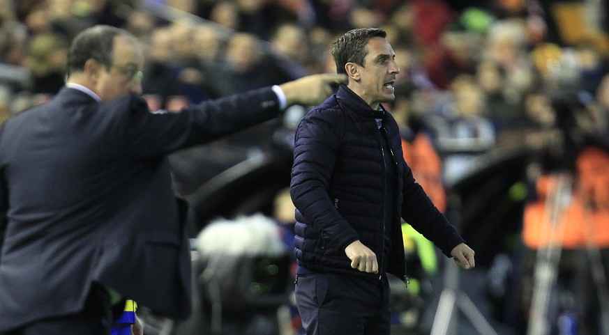 Valencia's head coach Gary Neville gestures to the players during a Spanish La Liga soccer match against Real Madrid at the Mestalla stadium in Valencia, Spain, Sunday, Jan. 3, 2015. (AP Photo/Alberto Saiz)