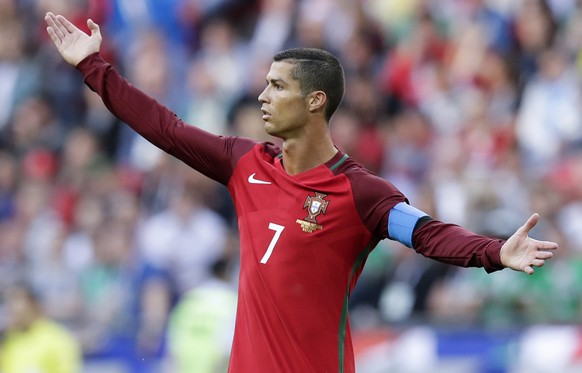 Portugal's Cristiano Ronaldo calls for referee's attention during the Confederations Cup, Group A soccer match between Portugal and Mexico, at the Kazan Arena, Russia, Sunday, June 18, 2017. (AP Photo/Thanassis Stavrakis)