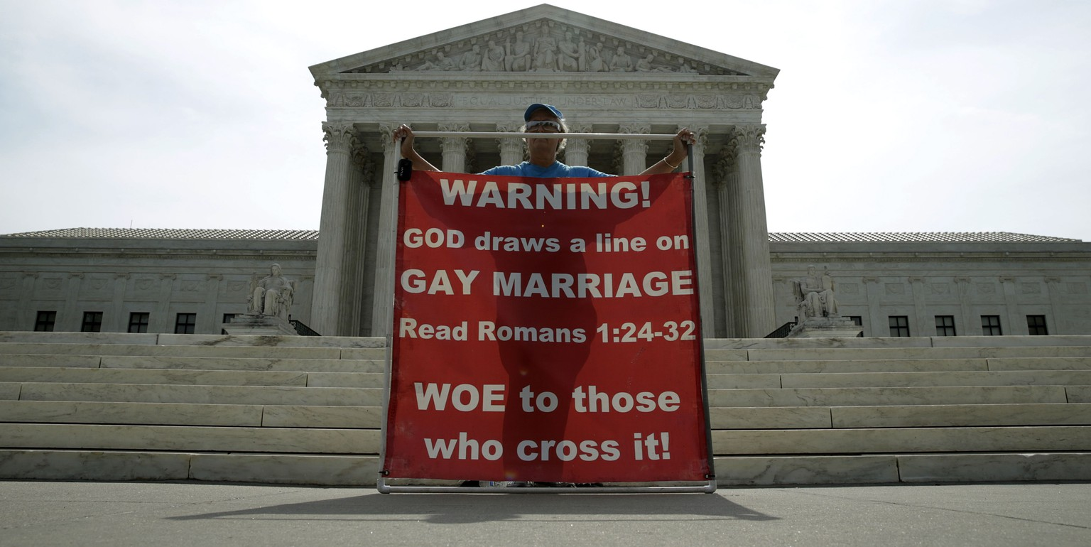 Christine Weick protests against gay marriage in front of the U.S. Supreme Court in Washington June 8, 2015.  A ruling on Obergefell v. Hodges, and whether the U.S. Constitution's guarantees of due process and equal protection under the law covers a right to same-sex marriage; and, if not, whether states that ban same-sex marriages must recognize those performed elsewhere, is expected from the Court by month's end. REUTERS/Gary Cameron