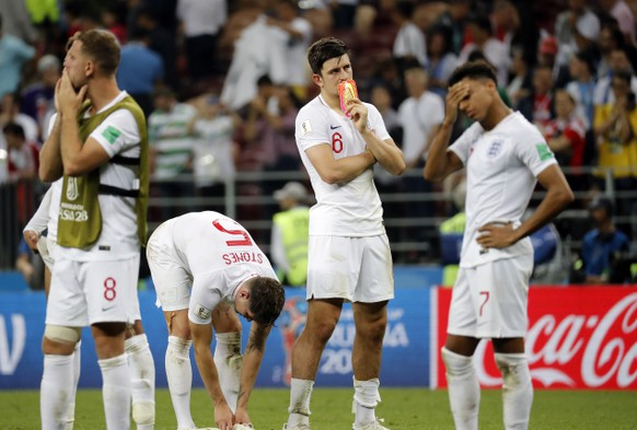 epa06882036 Harry Maguire of England (2R) and teammates react after the FIFA World Cup 2018 semi final soccer match between Croatia and England in Moscow, Russia, 11 July 2018.