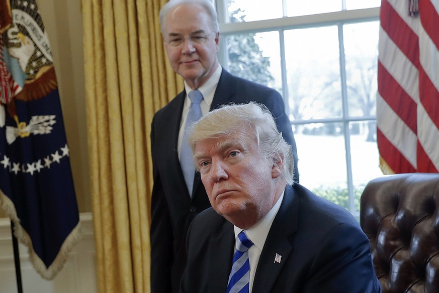 FILE - In this March 24, 2017 file photo, President Donald Trump with Health and Human Services Secretary Tom Price are seen in the Oval Office of the White House in Washington. Price resigned Sept. 29, after his costly travel triggered investigations that overshadowed the administration's agenda and angered his boss. Price's regrets and partial repayment couldn't save his job. (AP Photo/Pablo Martinez Monsivais, File)