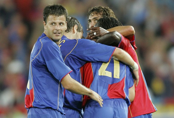 TECHNICAL REPEAT****Basel's Mile Sterjovski, left, celebrates with his teammates Basel's first goal during the UEFA Champions League, third qualifying round soccer match opposing FC Basel to Werder Bremen, in the St. Jakob Park in Basel, Switzerland, Wednesday, August 10, 2005. (KEYSTONE/Patrick Straub)