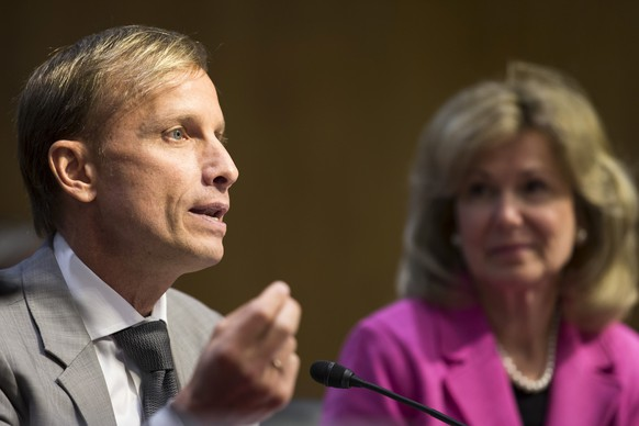 Dr. Mark Dybul, executive director of the Global Fund to Fight AIDS, Tuberculosis and Malaria, accompanied by Ambassador at Large and Coordinator of the U.S. Government Activities to Combat HIV/AIDS, Dr. Deborah L. Birx, testifies on Capitol Hill in Washington, Wednesday, May 6, 2015, before the Senate State, Foreign Operations, and Related Programs subcommittee in support of U.S. funding for global HIV/AIDS treatment.  (AP Photo/Brett Carlsen)