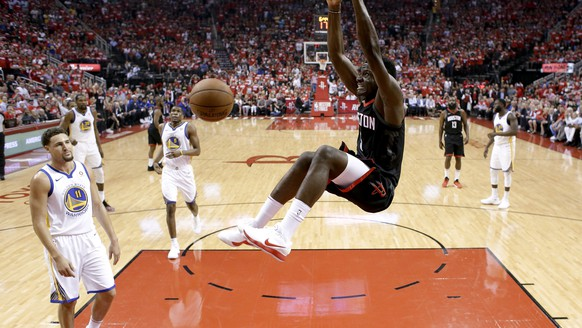 Houston Rockets center Clint Capela dunks against the Golden State Warriors during the first half of Game 5 of the NBA basketball playoff Western Conference finals Thursday, May 24, 2018, in Houston. (AP Photo/David J. Phillip)