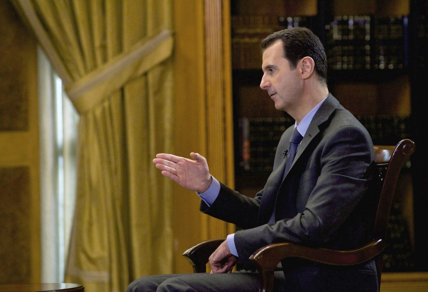 FILE - In this file photo released Wednesday, March 4, 2015, by the Syrian official news agency SANA, Syrian President Bashar Assad speaks during an interview with Portuguese state television, RTP, in Damascus, Syria. Speaking in an interview with Russian media, Tuesday, Sept. 15, 2015, Assad said the refugee crisis now hitting Europe is a direct result of the West's support of