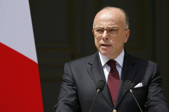 French Interior Minister Bernard Cazeneuve speaks at the ministry in Paris, France, June 22, 2016 after he authorised a short route allowing French trade unions to hold a protest march against labour reforms in the French capital on Thursday after an earlier decision to ban the demonstration.   REUTERS/Stephane Mahe