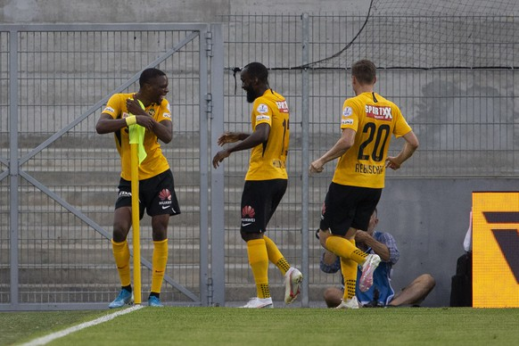 Young Boys' midfielder Christopher Martins, left, celebrates his goal past teammates midfielder Nicolas Moumi Ngamaleu, center, and midfielder Michel Aebischer, right, after scoring the 0:1, during the Super League soccer match between FC Sion and BSC Young Boys, at the Stade de Tourbillon stadium, in Sion, Switzerland, Friday, July 31, 2020. All Super League soccer matches of Swiss Championship are played to behind the semi closed doors (only 1000 persons can be present in the stadium) due to preventive measure against a second wave of the coronavirus COVID-19. (KEYSTONE/Salvatore Di Nolfi)