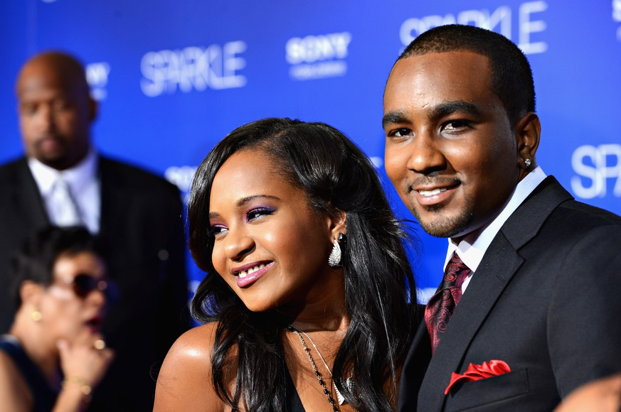 FILE - JANUARY 31, 2015: It was reported that Bobbi Kristina Brown, daughter of Whitney Houston, was rushed to a hospital after being found unresponsive in a bathtub January 31, 2015 in Roswell, Georgia. HOLLYWOOD, CA - AUGUST 16:  Bobbi Kristina Brown (R) and Nick Gordon arrive at Tri-Star Pictures'