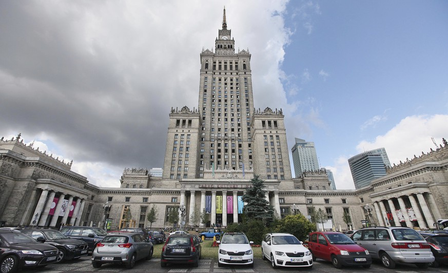 FILE - In this July 20, 2015 file photo, cars are parked in front of the Palace of Culture and Science in Warsaw, Poland. Two leading members of the Polish government are calling for the destruction of the building, a Stalinist-era skyscraper that dominates the Warsaw city skyline and recalls the country's subservience to Moscow during the Cold War, it was announced on Wednesday, Nov. 15, 2017. (AP Photo/Czarek Sokolowski, file)
