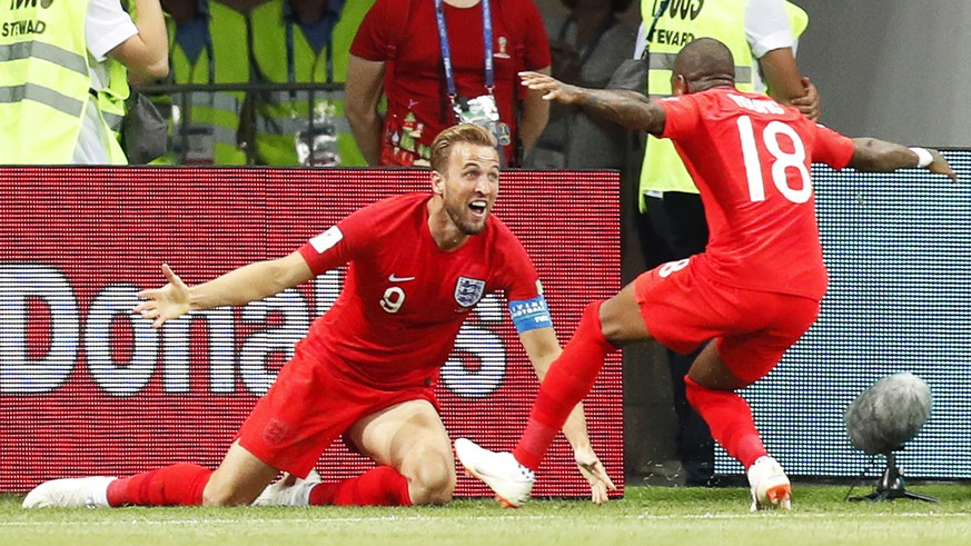 epa06819831 Harry Kane (L) of England celebrates with his teammate Ashley Young (R) after scoring the winning goal during the FIFA World Cup 2018 group G preliminary round soccer match between Tunisia and England in Volgograd, Russia, 18 June 2018. England won 2-1.