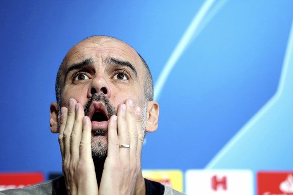 Manchester City manager Pep Guardiola during the press conference at the City Football Academy in Manchester, England, Tuesday April 16, 2019. Man City will play Tottenham in their Champions League Quarter Final 2nd leg soccer match on upcoming Wednesday. (Martin Rickett/PA via AP)
