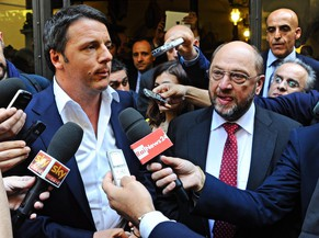 epa04198384 Italy's Prime Minister Matteo Renzi (L) and Germany's Martin Schulz, candidate for the helm of the European Commission, are interviewed by reporters after a lunch in a restaurant in Florence, 09 May 2014. Sociali Democratic contender Martin Schulz, who currently is Speaker of the European Parliament, visits various EU countries on a campaign tour.  EPA/MAURIZIO DEGL' INNOCENTI