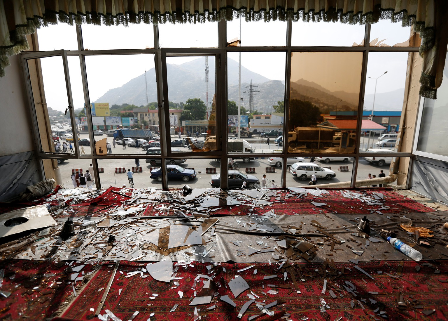 Broken glass and debris are seen inside a resturant a day after a suicide attack in Kabul, Afghanistan July 24, 2016. REUTERS/Mohammad Ismail      TPX IMAGES OF THE DAY