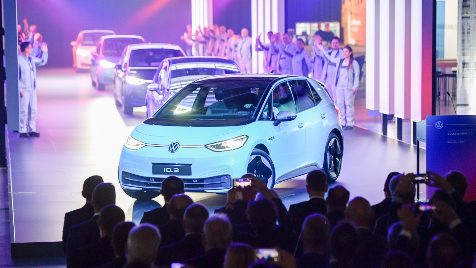 epa07971807 ID.3 cars during a presentation on the occasion of the start of the production of the new electric car Volkswagen ID.3 at the Volkswagen (VW) vehicle factory in Zwickau, Germany 04 November 2019. The ID.3 is Volkswagen's first product in an affordable range of full-electric vehicles based on the MEB-platform. The ID.3 will be available with three battery options: standard range, mid range and long range. Production starts in November 2019 and customers will begin taking delivery of their cars in the summer of 2020.  EPA/JENS SCHLUETER
