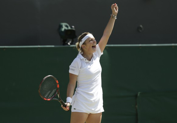 Timea Bacsinszky of Switzerland celebrates defeating Sabine Lisicki of Germany during their singles match at the All England Lawn Tennis Championships in Wimbledon, London, Saturday July 4, 2015. Bacsinszky won the match 6-3, 6-2. (AP Photo/Alastair Grant)
