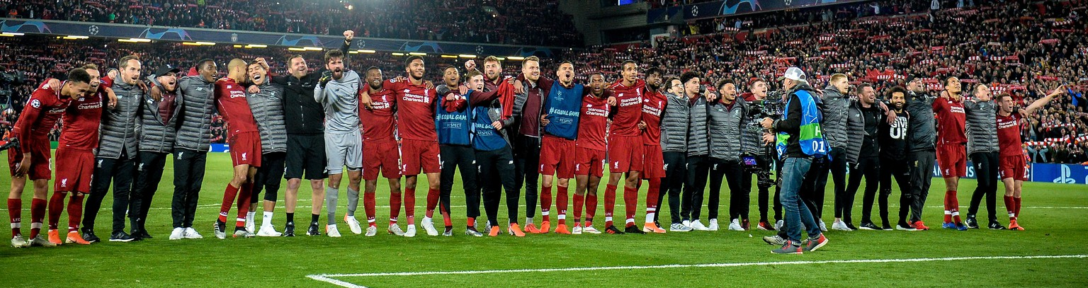 epa07554703 The team of Liverpool celebrates after winning the UEFA Champions League semi final second leg soccer match between Liverpool FC and FC Barcelona in Liverpool, Britain, 07 May 2019. Liverpool won 4-3 on aggregate.  EPA/PETER POWELL