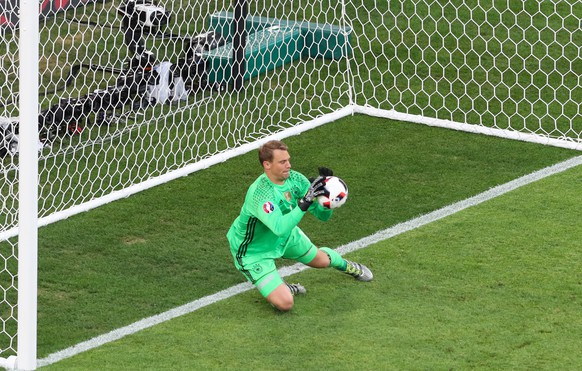 Germany goalkeeper Manuel Neuer saves a ball during the Euro 2016 semifinal soccer match between Germany and France, at the Velodrome stadium in Marseille, France, Thursday, July 7, 2016. (AP Photo/Thibault Camus)