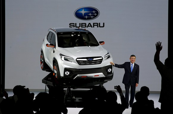 REFILE - CORRECTING MODEL OF CAR   Yasuyuki Yoshinaga, president and chief executive officer of Fuji Heavy Industries Ltd, the maker of Subaru cars, poses next to a Subaru Viziv Future concept car at the 44th Tokyo Motor Show in Tokyo, Japan, October 28, 2015.   REUTERS/Thomas Peter