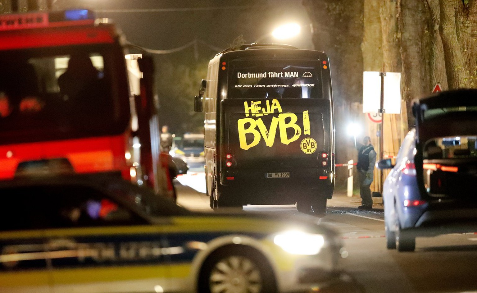 epa05903577 Team bus of Borussia Dortmund is seen on a street after it was hit by three explosions in Dortmund, Germany, 11 April 2017. According to reports, Borussia Dortmund's team bus was damaged by three explosions on 11 April, as it was on its way to the stadium ahead of the UEFA Champions League soccer match between BVorussia Dortmund and AS Monaco. Borussia Dortmund's player Marc Bartra was injured and is hospitalized. The match has been postponed.  EPA/FRIEDEMANN VOGEL BEST QUALITY AVAILABLE