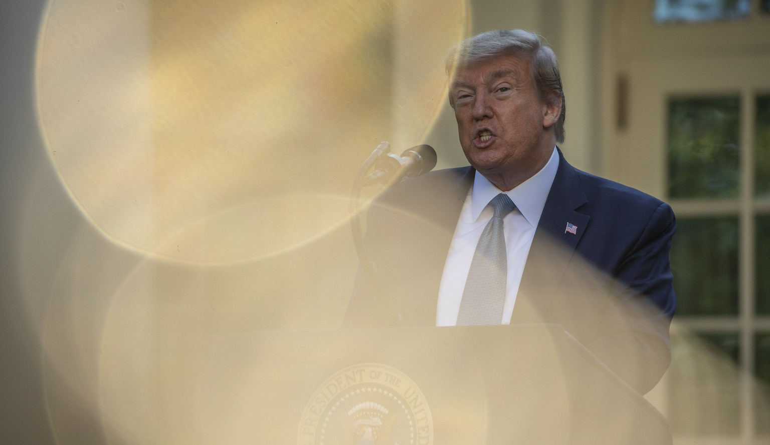 President Donald Trump speaks about the coronavirus in the Rose Garden of the White House, Wednesday, April 15, 2020, in Washington. (AP Photo/Alex Brandon) Donald Trump
