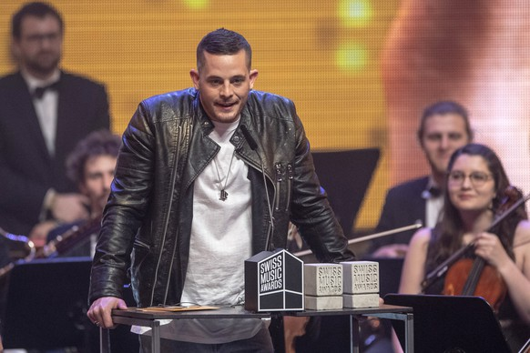 epa07376182 Swiss singer Loco Escrito receives an award for the 'Best Hit' during the Swiss Music Awards 2019 ceremony in Lucerne, Switzerland, 16 February 2019.  EPA/URS FLUEELER