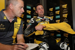 Swiss Moto 2 rider Thomas Luthi of the Interwetten Paddock Moto2 Team has a talk with team members at the end of the free practice session of the Moto2 World Championship at the Bugatti race track in Le Mans, western France, Friday, May 16, 2014. The race will start Sunday. (AP Photo/David Vincent)