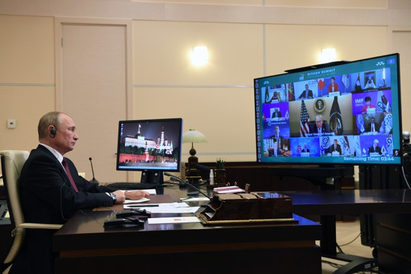 epa08833306 Russian President Vladimir Putin takes part in a virtual  G20 Summit 2020 via a videoconference at the Novo-Ogaryovo state residence outside Moscow, Russia, 21 November 2020. The G20 summit 2020 is held on in a virtual format due to Covid-19 pandemic caused by SARS-CoV-2 coronavirus.  EPA/ALEXEI NIKOLSKY / SPUTNIK / KREMLIN / POOL MANDATORY CREDIT