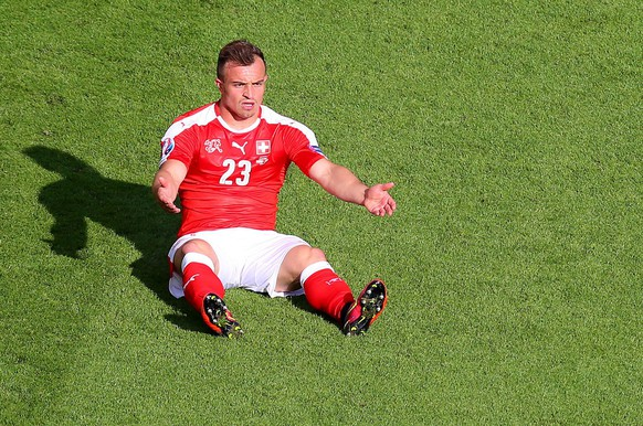 epa05367504 Xherdan Shaqiri of Switzerland reacts during the UEFA EURO 2016 group A preliminary round match between  Romania and Switzerland at Parc de Princes in Paris, France, 15 June 2016.
