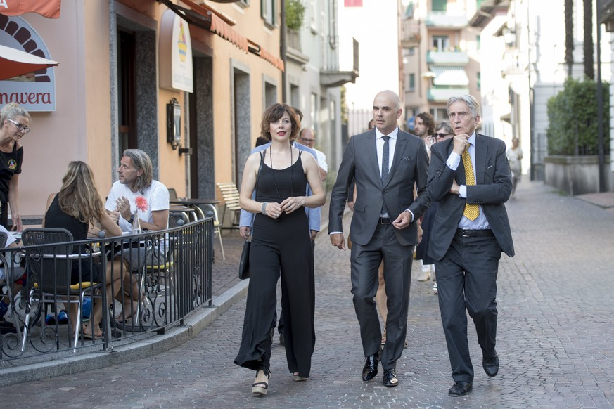 epa06121606 Swiss Federal Councillor Alain Berset (C), his wife Muriel (L) and the President of the Locarno Film Festival Marco Solari, (R) arrive for the official opening of the 70th Locarno International Film Festival in Locarno, 02 August 2017. The event runs from 02 to 12 August.  EPA/URS FLUEELER