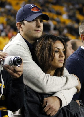 (FILE PHOTO) Mila Kunis and Ashton Kutcher Are Expecting A Baby Girl Together PITTSBURGH, PA - SEPTEMBER 22:  Ashton Kutcher and Mila Kunis look on from the sidelines before the game between the Chicago Bears and the Pittsburgh Steelers on September 22, 2013 at Heinz Field in Pittsburgh, Pennsylvania.  (Photo by Justin K. Aller/Getty Images)