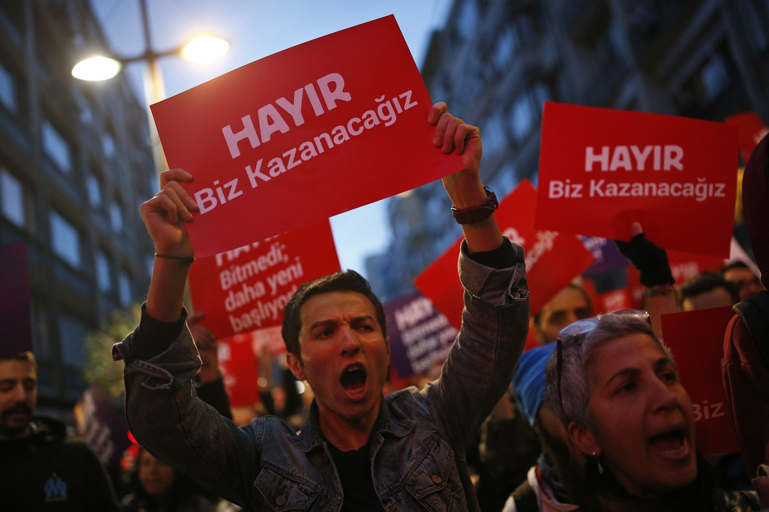 Supporters of the 'no' vote protest in Istanbul, against the referendum outcome, Monday, April 17, 2017. The placards reads in Turkish: 'No we will win'. Turkey's main opposition party urged the country's electoral board Monday to cancel the results of a landmark referendum that granted sweeping new powers to Erdogan, citing what it called substantial voting irregularities. (AP Photo/Emrah Gurel)