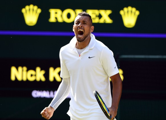 epa07695169 Nick Kyrgios of Australia scores against Rafael Nadal of Spain in their second round match during the Wimbledon Championships at the All England Lawn Tennis Club, in London, Britain, 04 July 2019. EPA/FACUNDO ARRIZABALAGA EDITORIAL USE ONLY/NO COMMERCIAL SALES