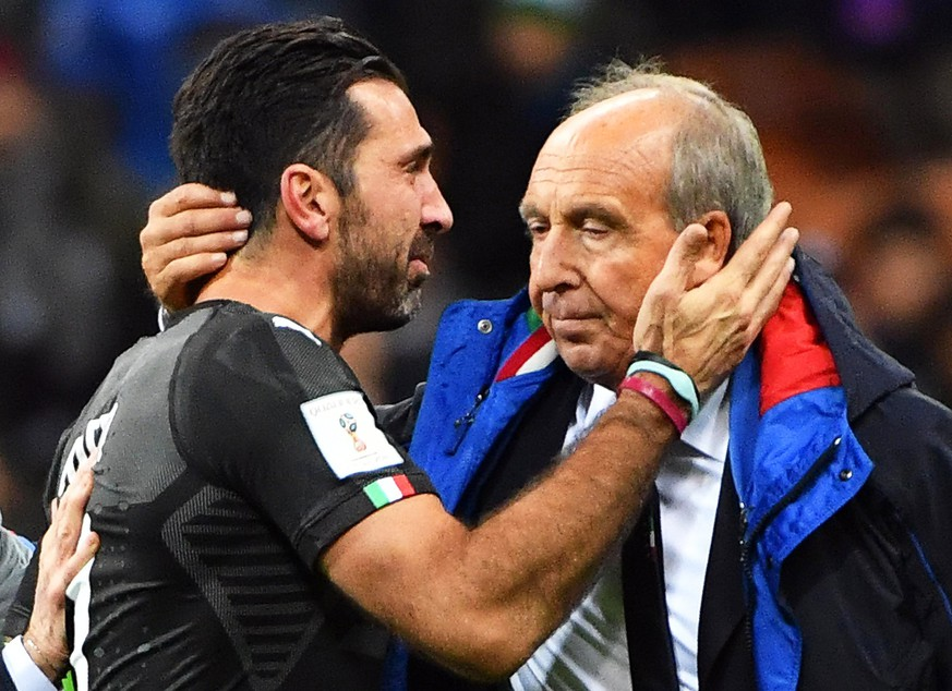 epaselect epa06327491 Italy's goalkeeper Gianluigi Buffon (L) and head coach Gian Piero Ventura (R) show their dejection after the FIFA World Cup 2018 qualification playoff, second leg soccer match between Italy and Sweden at the Giuseppe Meazza stadium in Milan, Italy, 13 November 2017. Sweden won 1-0 on aggregate.  EPA/DANIEL DAL ZENNARO