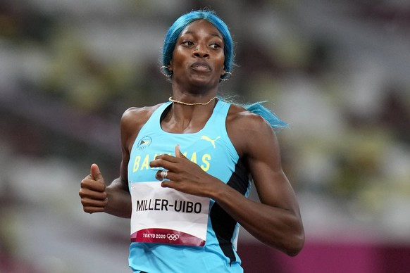 Shaunae Miller-Uibo, of the Bahamas, wins a women's 400-meter semifinal at the 2020 Summer Olympics, Wednesday, Aug. 4, 2021, in Tokyo. (AP Photo/Petr David Josek)